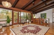 Formal living room view with door to deck