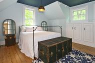 Master suite with bath, built ins, vaulted ceiling and pine floors. The feeling of a weekend getaway everyday!