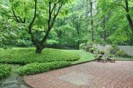 Brick patio and lush landscaping. A true Summer retreat.
