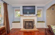 Built in window seats flank fireplace